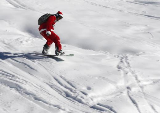 A man, dressed as Santa Claus, speeds down during a promotional event on the opening weekend in the alpine ski resort of Verbier, Switzerland, December 6, 2015. Skiers dressed as Santa Claus were granted free access to the resort on the day of Saint-Nicolas. REUTERS/Denis Balibouse